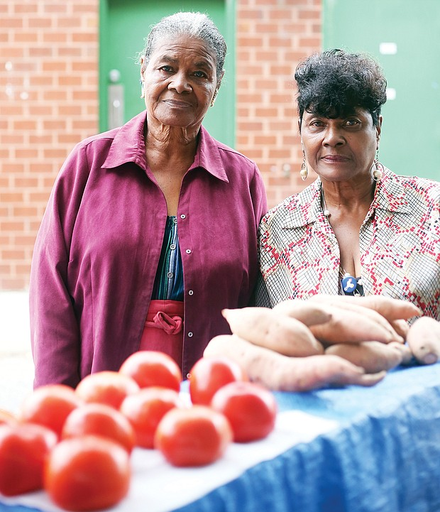 Sisters Evelyn Luceal Allen, left, and Rosa L. Fleming have been coming to the 17th Street Farmers' Market since they were youngsters. For more than 75 years, they have helped family members sell produce grown on the family farm in Hanover before they took over decades ago.