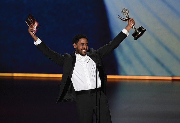 """Jharrel Jerome celebrates after receiving an Emmy for outstanding lead actor in a limited series or movie for """"When They See Us,"""" the Netflix miniseries by Ava DuVernay about the five teens wrongly convicted for the 1989 rape of a jogger in New York's Central Park. He dedicated his win to the five, now known as the Exonerated Five."""