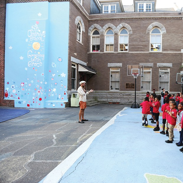 Students at St. Andrew's School join art teacher Chris Milk on Monday to get their first look at the mural  they all helped create to mark the 125th year of the private school based in Oregon Hill.