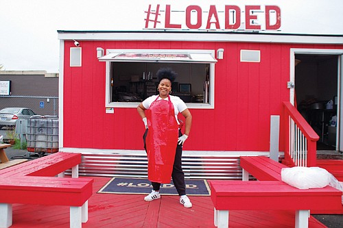 Kiauna Nelson, owner of Kee's #Loaded Kitchen,  Portland's most favorite food cart as rated in a reader poll by Willamette Week, gets ready to serve one of her original dishes of the day at 3624 N.E. Martin Luther King Jr. Blvd.