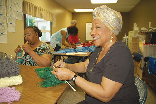 Patrishia Probasco joined Warm Heads and Hearts after taking a class from the group to learn the craft of making handmade clothes. Now she donates her time to give hats and scarves to the homeless.