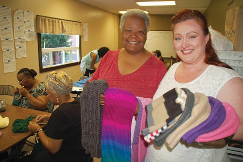 A diverse volunteer sewing group stitches winter warmth for homeless residents