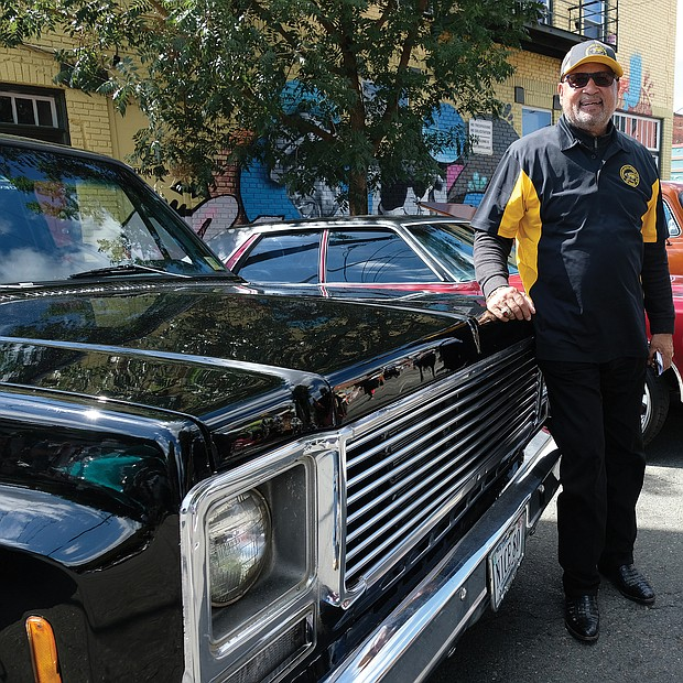 C.T. Woody, former Richmond sheriff, shows off his vintage Chevrolet with the vehicles shown at the festival by the Richmond Metropolitan Antique Car Club. (Sandra Sellars/Richmond Free Press)