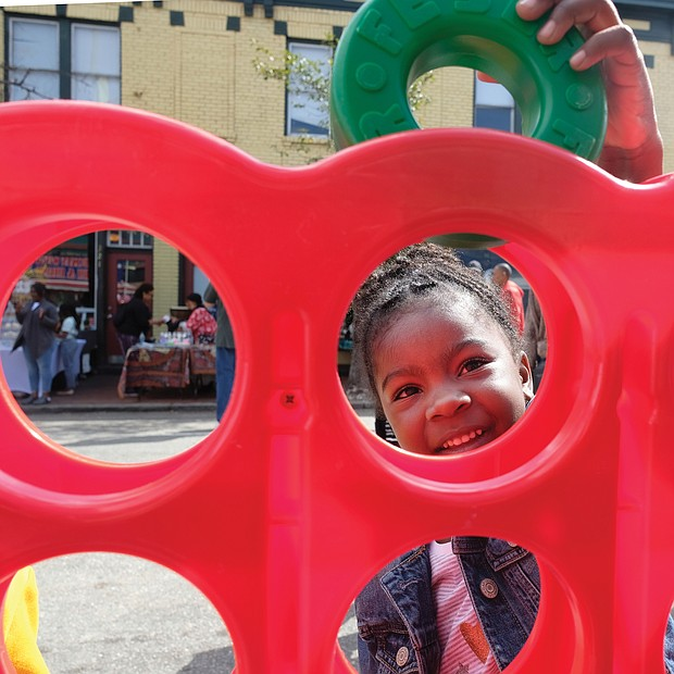 Iyana Reeder, 5, plays a game at the special Kidz Zone last Saturday at the 2nd Street Festival in Richmond's Historic Jackson Ward. Thousands of people turned out for the free, two-day festival. (Sandra Sellars/Richmond Free Press)