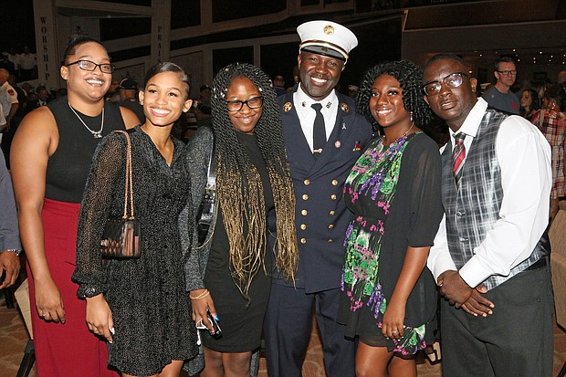 Fire Rescue Chief Malcolm Moore with his family