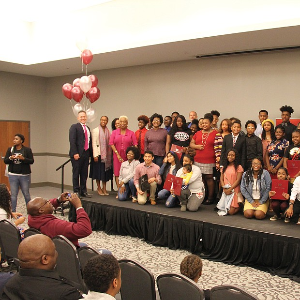 "Fifty ninth-graders from Richmond Public Schools pose with officials last Saturday for photographs by happy parents and family members as they are celebrated for receiving four-year academic scholarships to Virginia Union University. The students must keep up their grades and finish high school before enrolling tuition-free at VUU, where their room and board also will be covered by a scholarship currently valued around $108,000. The scholarships are part of the HBCUs ""VUU is RVA"" campaign to