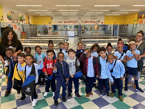 Students from P.S. 154 Harriet Tubman Learning Center after receiving their fully stocked backpacks from The Allure Group's Harlem Center for Nursing and Rehabilitation