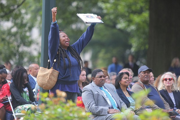 """Feeling the spirit of the moment, Teddy Parham of Richmond responds to singer Joyce Johnson Rouse's musical tribute """"Standing on the Shoulders"""" during the ceremony."""