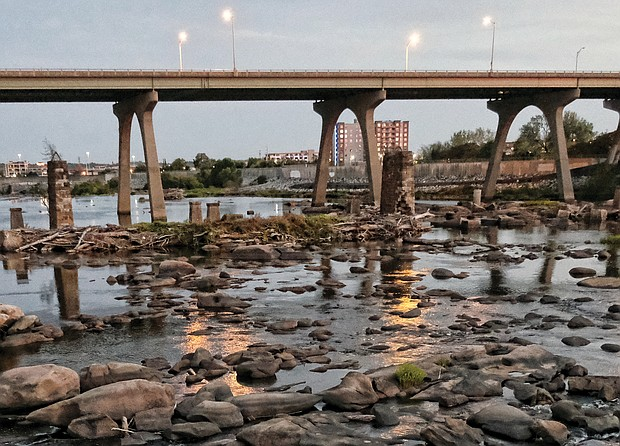 Rocks typically covered by the rushing waters of the James River are now visible because of low water levels. This view of the river, taken Tuesday evening near the Manchester Bridge, is emblematic of the severe drought that has gripped much of Virginia in the past two months.
