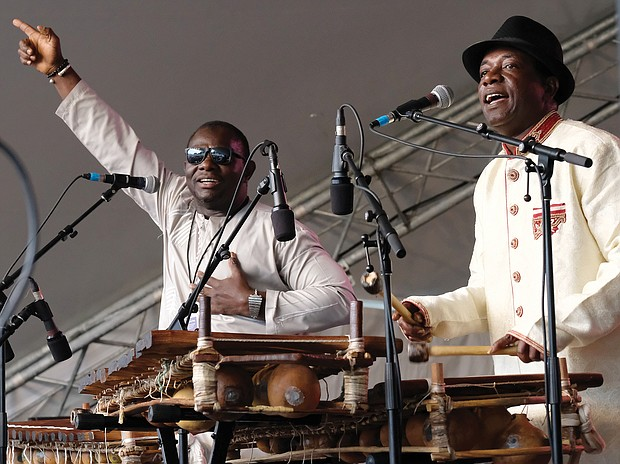 Lots of music, lots of folk/Richmond's Downtown riverfront came alive with people and music last weekend as thousands of people turned out for the Richmond Folk Festival. Balla Kouyaté of Mali and Famoro Dioubaté from Guinea, balafon masters, treat the audience to their modern and inventive sounds on an ancient instrument. (Sandra Sellars/Richmond Free Press)