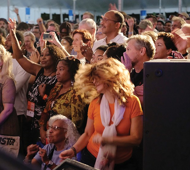 Lots of music, lots of folk/Richmond's Downtown riverfront came alive with people and music last weekend as thousands of people turned out for the Richmond Folk Festival. Audiences of all ages engage and let loose during the performances. (Sandra Sellars/Richmond Free Press)