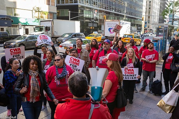 Verizon Wireless workers and elected officials want the telecommunications giant to quash racial discrimination in their midst.