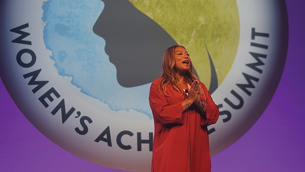 Entertainer Queen Latifah engages the crowd of more than 1,000 people Tuesday as the host of the Women's Achieve Summit at the Greater Richmond Convention Center.