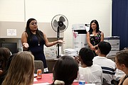 Tanya Arias, from the Will County Clerk's Voter Registration Department, talks with Student Ambassadors about the importance of being involved in your local community. Arias, who was recently hired by the Will County Clerk's Office, serves with the Collins Street Neighborhood Council in Joliet and with the Spanish Community Center in Joliet.