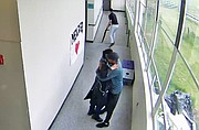 Surveillance video from Parkrose High School shows Parkrose coach and security guard Keanon Lowe holding a student in an embrace after disarming him of a shotgun during an incident last May. Lowe handed the gun to another teacher who is seen taking it away from the scene.