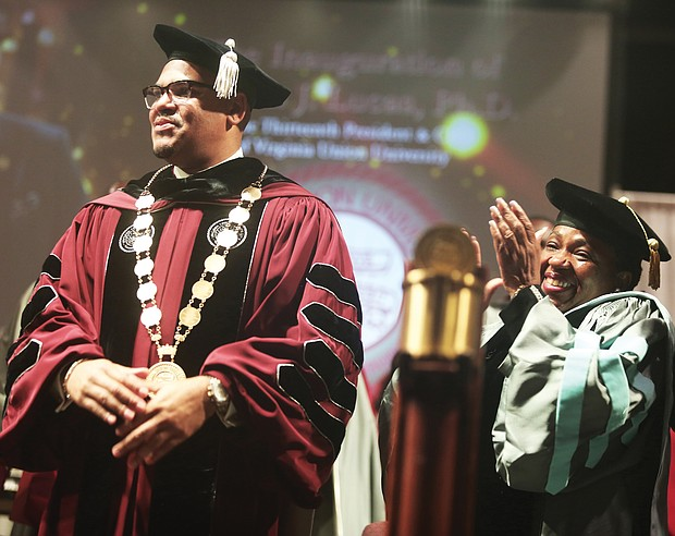Dr. Hakim J. Lucas is applauded by an audience of hundreds and his mother, Bishop Barbara Austin Lucas, during his inauguration as Virginia Union University's 13th president during a ceremony Oct. 17 at the Greater Richmond Convention Center. Bishop Lucas is founder and senior pastor of Agape Tabernacle International Fellowship in Brooklyn, N.Y.