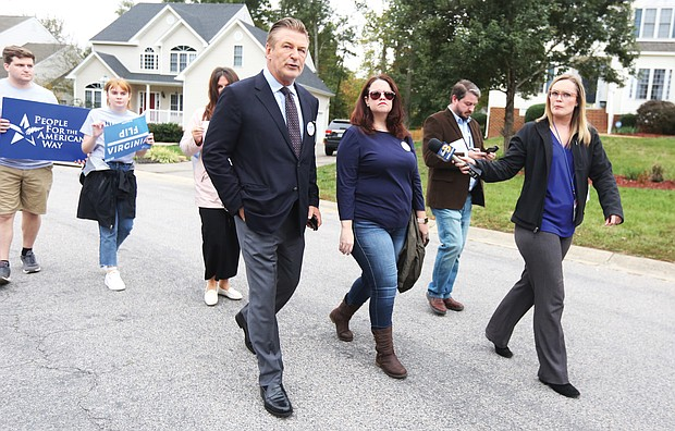 Election star power:  With reporters in tow, popular movie and TV actor Alec Baldwin stumps for votes on Tuesday with Democratic state Senate candidate Amanda Pohl, right, and her supporters in a Midlothian subdivision in Chesterfield County. Mr. Baldwin came to rally support for Ms. Pohl, who is seeking to upset Republican incumbent Sen. Amanda Chase in the 11th Senate District. Along with the visit to the Richmond suburb, Mr. Baldwin also made campaign stops for candidates in Fredericksburg and Fairfax County. His one-day electioneering trip to Virginia was organized by People for the American Way, which has endorsed the Democratic candidates.