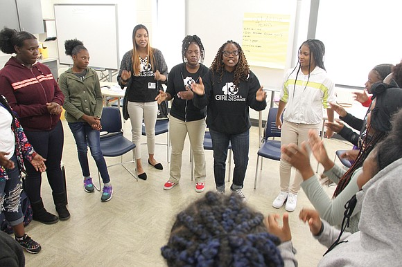 Fourteen eighth-grade girls came together at Richmond's Martin Luther King Jr. Middle School in a room set up in the ...