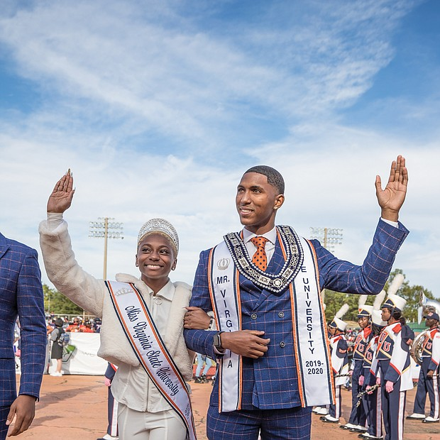 Miss VSU Dayana Lee of Virginia Beach and Mr. VSU Fredricks Sanders of Charlotte, N.C., wave to the homecoming crowd as they are introduced with the royal court.