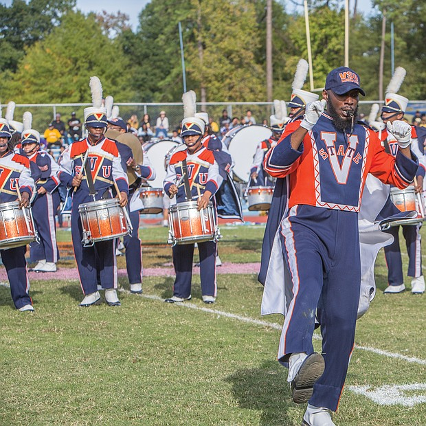 A drum major with the VSU Trojan Explosion Marching Band takes the first steps onto the field at Rogers Stadium in Ettrick. Recent restrictions were lifted on the band, allowing the musicians to participate in homecoming.