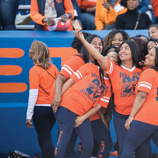 Alumni members of the VSU Woo Woos cheerleading squad celebrating their 20th anniversary pause for a selfie on the sidelines at Rogers Stadium. The former cheerleaders were invited to participate in some of the cheers during the game.