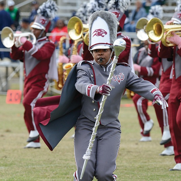 Diamond McGhee, one of two drum majors with the VUU Ambassadors of Sound Marching Band, takes charge during the halftime show at Hovey Field.