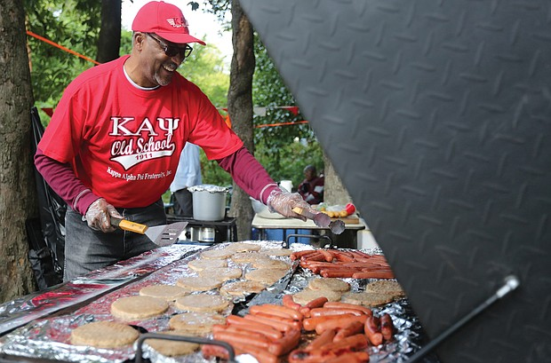 Westley Steele, a member of Kappa Alpha Psi Fraternity, works the grill in preparation for a lot of hungry tailgaters.