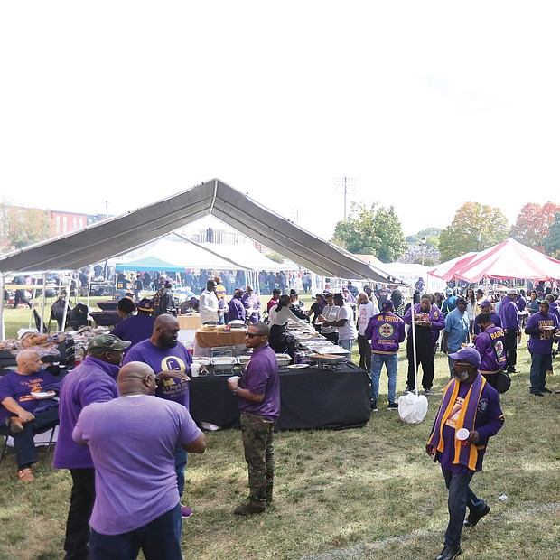 Members of the Omega Psi Phi Fraternity Zeta Chapter, celebrating their 100th anniversary last weekend join scores of people for the tailgating before and after the football game against Chowan University.