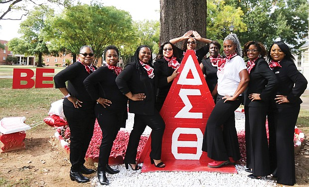 Members of the Delta Sigma Theta Sorority Beta Epsilon Chapter celebrating their 35th reunion gather at the sorority's plot on the Lombardy Street campus for a group photo.