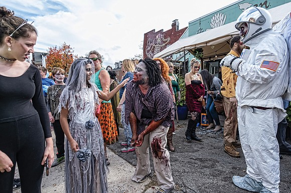 Carytown was filled with the living dead last Saturday as scores of ghoulishly costumed people participated in the 15th Annual ...