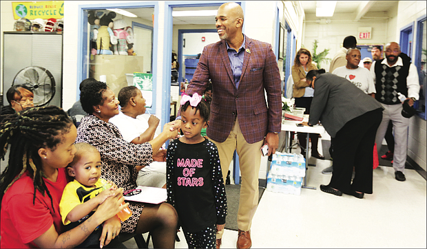 Damon E. Duncan, president and chief executive officer of the Richmond Redevelopment and Housing Authority, greets Richmond Delegate Delores L. McQuinn in the Creighton Court Community Center as tenants of the public housing community meet Monday to discuss the recent evictions.