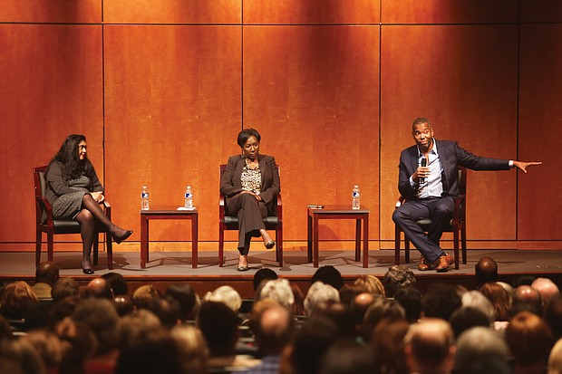 """Author Ta-Nehisi Coates makes a point during his talk Oct. 25 at the Virginia Museum of History & Culture. Other speakers on the panel for """"Legacies of Emancipation,"""" are Dr. Manisha Sinha, left, of the University of Connecticut, and Christy Coleman, chief executive officer of the American Civil War Museum."""