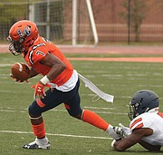 Lincoln University's Deontae Brockington makes some headway before being taken down by the Virginia State University defense in last Saturday's game at the school in Pennsylvania. VSU defeated Lincoln 33-5.