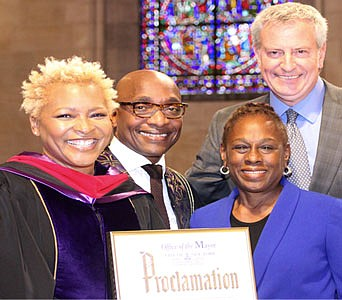 Dr. LaKeesha Walrond, Rev. Michael Walrond, First Lady Chirlane McCray and Mayor Bill de Blasio pose for a photo after Mayor de Blasio presented Dr. Walrond with a proclamation. (Photo credit: Brianna Rohleher)
