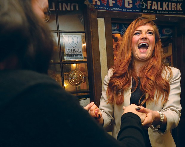 Stephanie A. Lynch celebrates her victory in the Richmond City Council 5th District contest with supporters Tuesday night at a Downtown restaurant.