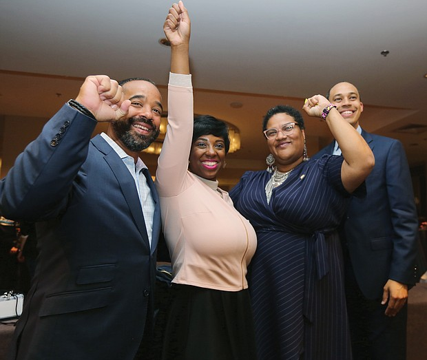 """Members of the Virginia Legislative Black Caucus cheer the gains made in Tuesday's election that will boost their membership numbers to 23 when the General Assembly convenes in January. They are, from left, Delegates Jeffrey M. Bourne, Lashrecse D. Aird, Marcia """"Cia"""" Price and Jerrauld C. """"Jay"""" Jones."""