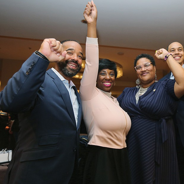 "Members of the Virginia Legislative Black Caucus cheer the gains made in Tuesday's election that will boost their membership numbers to 23 when the General Assembly convenes in January. They are, from left, Delegates Jeffrey M. Bourne, Lashrecse D. Aird, Marcia ""Cia"" Price and Jerrauld C. ""Jay"" Jones."