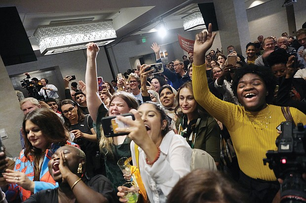 Hundreds of people break into jubilant cheers Tuesday night with the announcement that Democrats will control the General Assembly in January. The celebrants were at the Democratic Party's victory event held at a Downtown hotel.