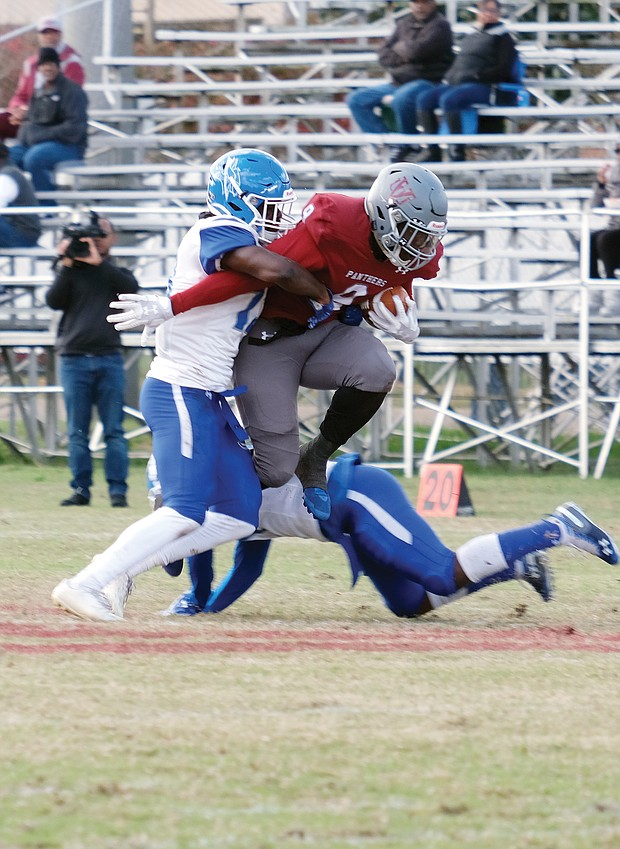 Virginia Union University running back Tabyus Taylor, right, skirts the Elizabeth City State University defense during last Saturday's game at Hovey Field. Taylor led the Panthers' running game with 98 yards and a touchdown.