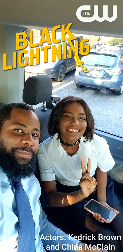 Kedrick Brown on set of Black Lightning with China McClain