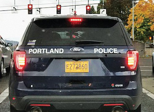 """A political """"Blue Lives Matter"""" sticker on the window of a Portland police squad car has drawn the ire of ..."""