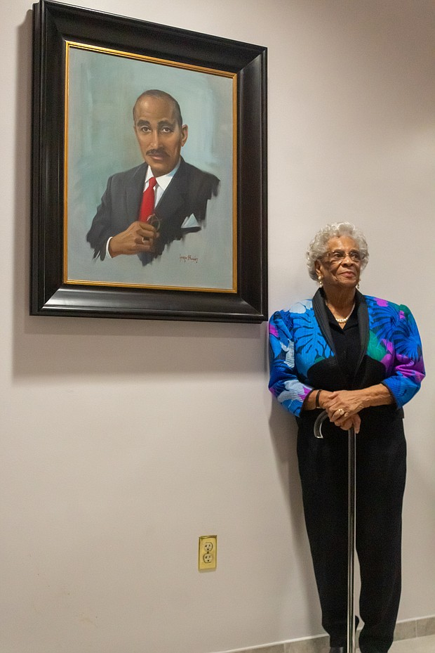 Ann Walker, widow of civil rights icon Dr. Wyatt Tee Walker, with the portrait of her late husband during Monday's ceremony at Virginia Union University.