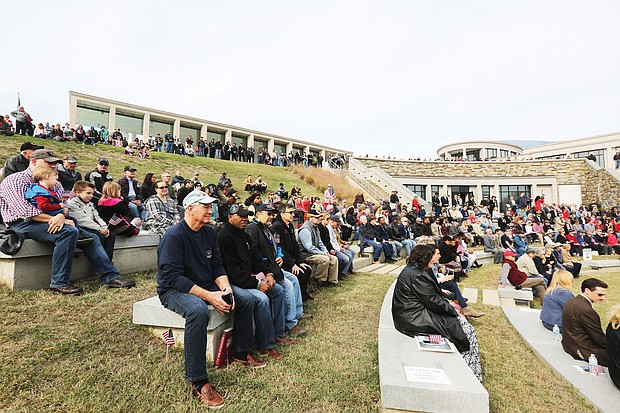 Alarge crowd gathers at the amphitheater at the Virginia War Memorial on South Belvidere Street in Downtown on Monday for the annual Veterans Day ceremony. Speeches and the skirl of bagpipes were part of the event paying tribute to soldiers, sailors, flyers, Marines and others who have served in the military.