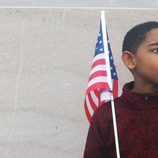 Tristan Williams, 8, takes in the sights and sounds Monday at the 63rd Annual Commonwealth Veterans Day Ceremony at the Virginia War Memorial in Downtown. The third-grader was attending the event with his Virginia Virtual Academy class members and their teacher, Deborah De Los Santos.