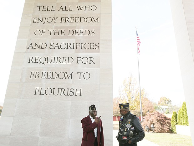Retired Army Maj. Willie A. Taylor of Richmond talks with decorated retired Army veteran Sammy Granderson of Fredericksburg about a late friend whose name is now engraved on a wall at the memorial.
