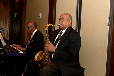 Robert J. Rucks on keyboards and David Smith, saxophonist