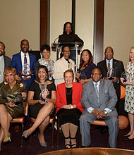 """(Front row): Dr. Elaine Simon; Pam Curtis; Publisher of The Baltimore Times, Joy Bramble; Mayor Bernard """"Jack"""" Young; (Back row): Jim Hamlin: George Mitchell; Charles """"Chazz"""" Scott; Monique Smith-Person; Vaile Leonard; Monica Mitchell; Dr. David Wilson; Browyn Mayden, MSW; and Jason Bass. LaTara Harris (at the podium) was Mistress of Ceremony."""