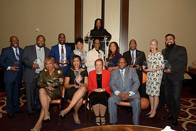 "(Front row): Dr. Elaine Simon; Pam Curtis; Publisher of The Baltimore Times, Joy Bramble; Mayor Bernard ""Jack"" Young; (Back row): Jim Hamlin: George Mitchell; Charles ""Chazz"" Scott; Monique Smith-Person; Vaile Leonard; Monica Mitchell; Dr. David Wilson; Browyn Mayden, MSW; and Jason Bass. LaTara Harris (at the podium) was Mistress of Ceremony."