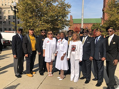 Veterans and their families proudly sport their military paraphernalia at Baltimore War Memorial Plaza during the Veterans Day Celebration November 11, 2019