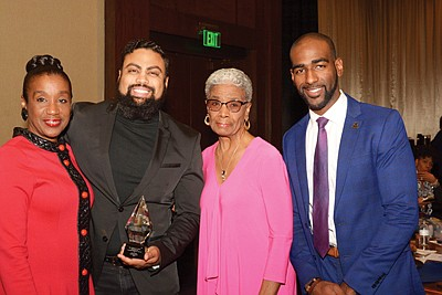 "(L-r): Denise Scott, (Ackneil's daughter); Jason Bass, awardee also received the Ackneil Muldrow, II award; Ruth Muldrow (Ackneil's widow); Charles ""Chazz"" Scott, (Ackneil's grandson)"